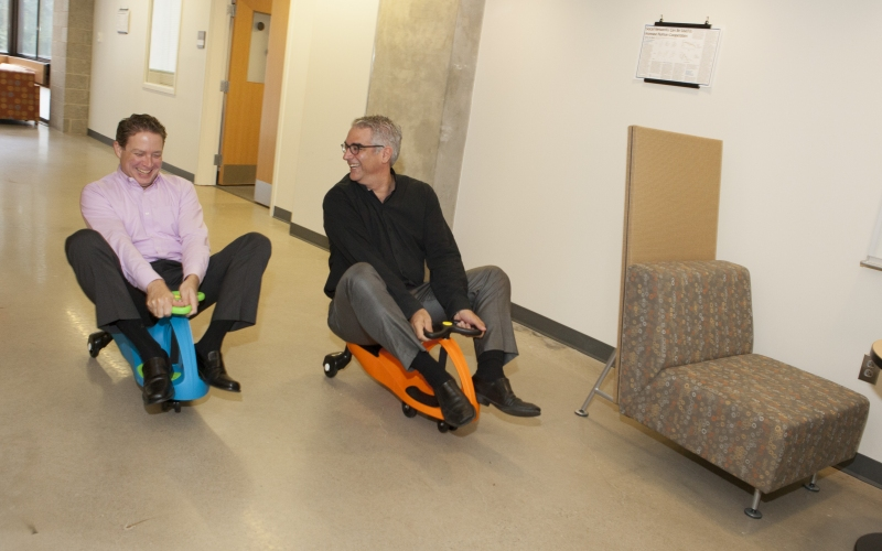 Executive Director Tom Keegan and Co-Director Nicholas Christakis race PlasmaCars, which are self-powered, and used to study defector networks.
